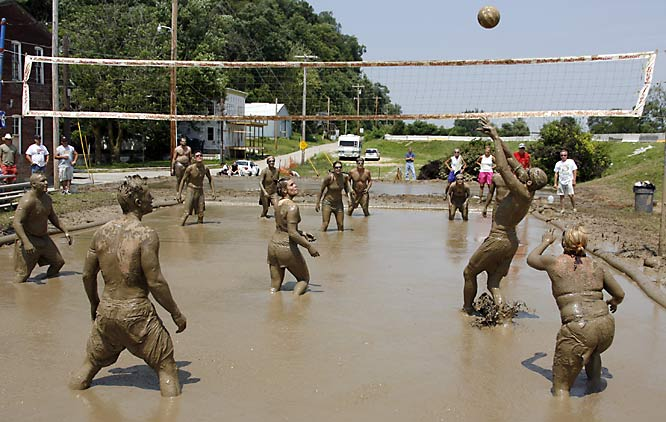 SI photographer David E. Klutho shot the Hannibal YMCA Men's Club 29th annual Mississippi Mud Volleyball Tournament earlier this month. Teams consisted of no more than eight players, with at least half of them female.