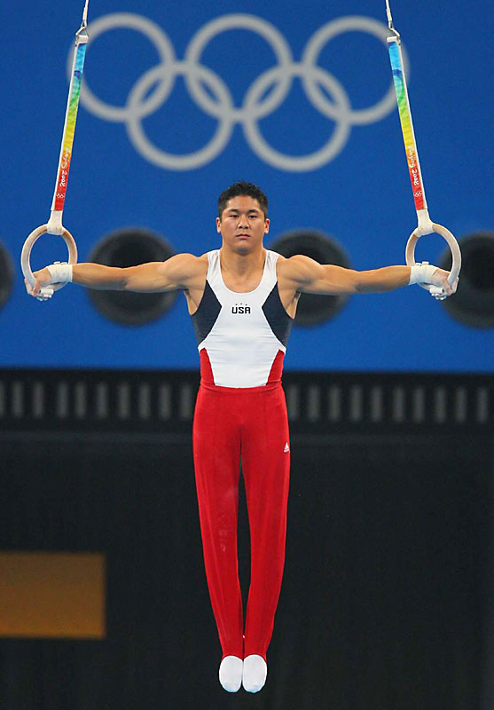 Gymnast Kai Wen Tan of the U.S.competes during qualifying.