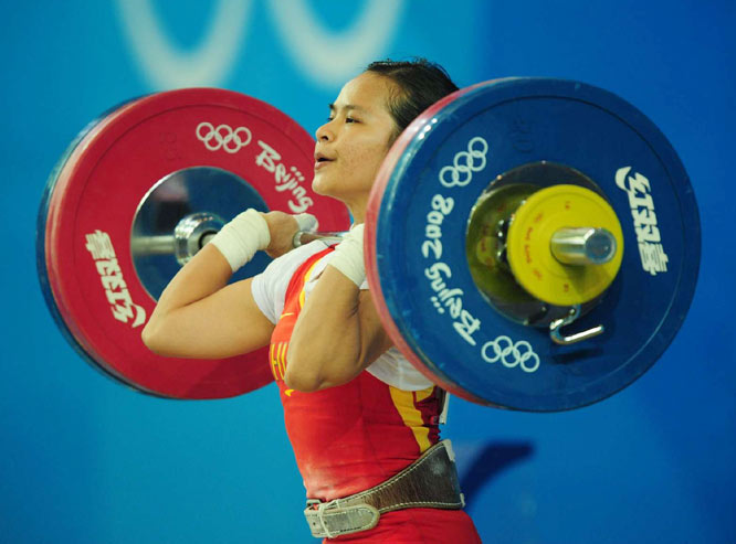 Weighlifter Chen Xiexia of China won the gold medal in the 48kg group.