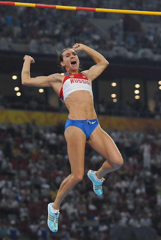 Elena Isinbaeva of Russia won a second consecutive gold in the pole vault, and broke her own world and Olympic records.