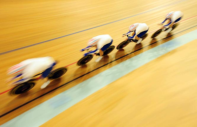 Blur action of Great Britain's gold medal track cycling team during the team pursuit finals.