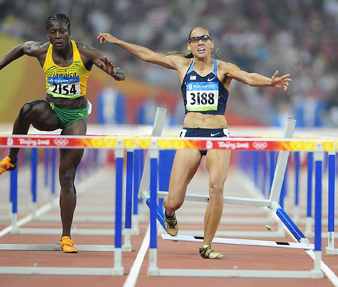Lolo Jones of the U.S. stumbles after tripping on the next to last hurdle in the 100-meter hurdles final, dropping from first to seventh place.