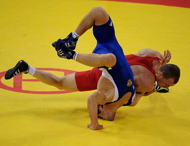 Mavlet Batirov of Russia won the 60-kilogram freestyle wrestling gold, defeating Vasyl Fedoryshyn of Ukraine.