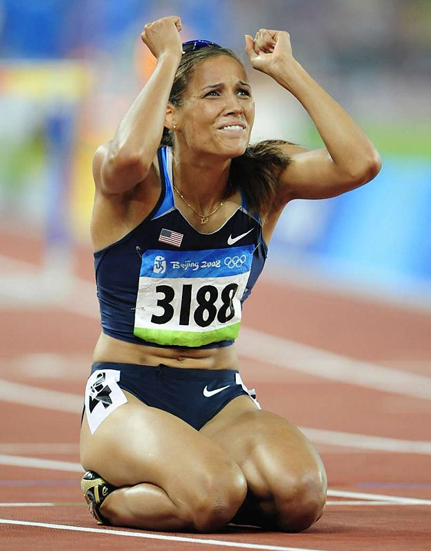 Lolo Jones reacts to finishing 7th after tripping on next to last hurdle.