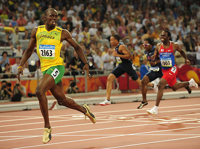 Usain Bolt ran a record 19.30 in the 200 on Wednesday, breaking Michael Johnson's mark of 19.32 set in 1996.