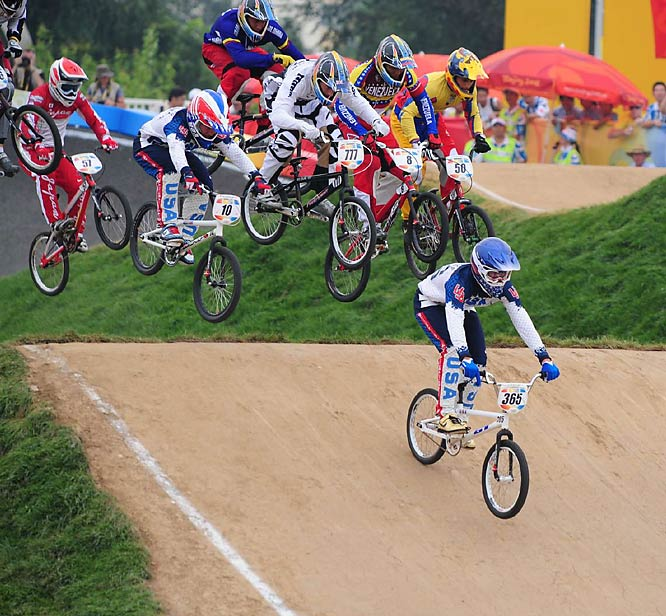 BMX made its debut in the Olympics at the Bejing Games on Wednesday as 16 women and men cruised into Thursday's semifinals. All three U.S. men advanced.