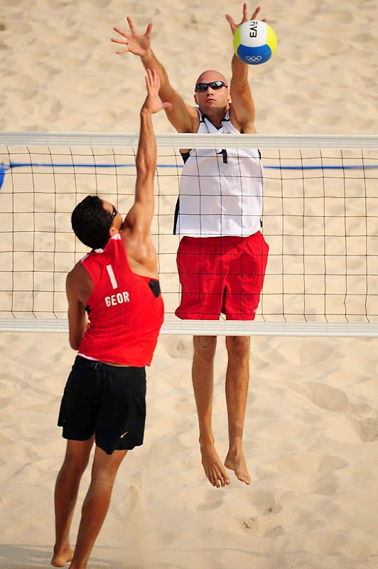 Phil Dalhausser (in white) goes up against Renato Gomes of Georgia. Dalhausser and Todd Rogers won 21-11, 21-13 and will play for gold on Friday.