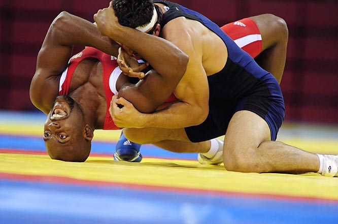 Michel Batista of Cuba wrestles George Gogshelidze of Georgia in the freestyle 74 kg quarterfinals.