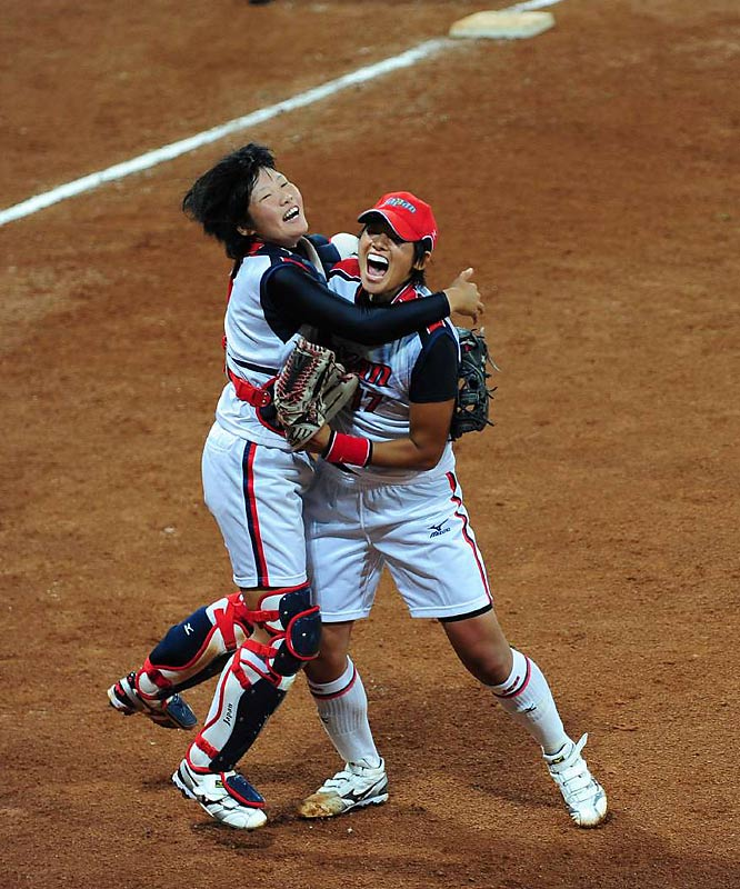 Yukiko Ueno and Yukiyo Mine of Japan celebrate winning the gold against the U.S. in softball.