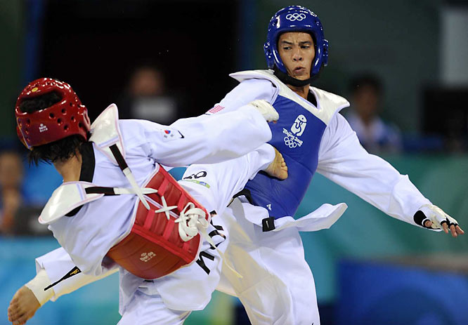 Son Taejin (left) scores the gold-medal winning point in the final seconds against Mark Lopez of the U.S.
