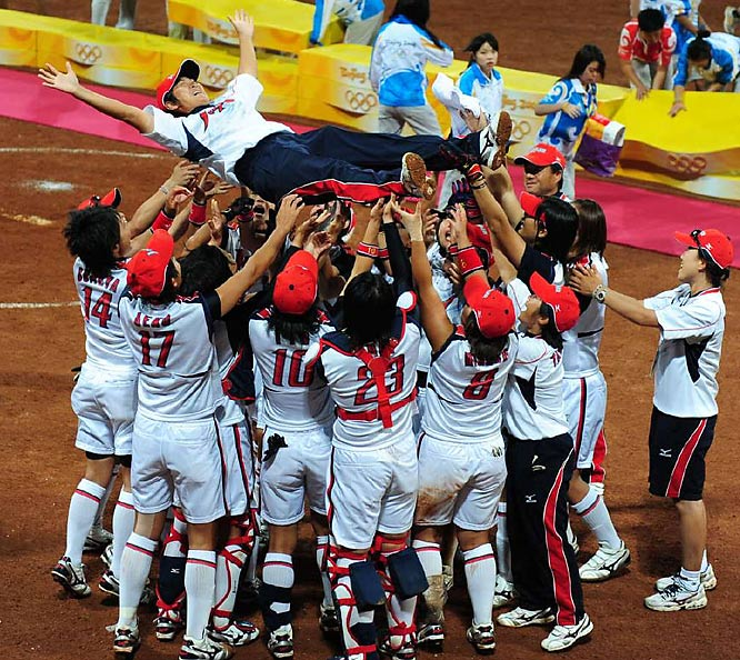 Japan celebrates winning the gold against the U.S. in softball.