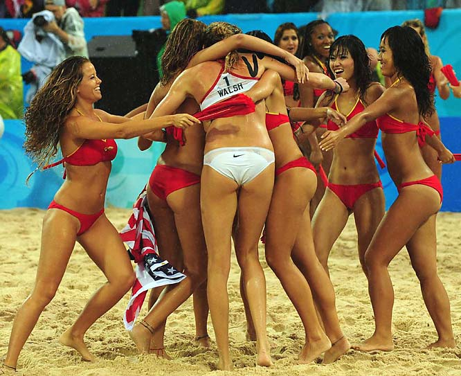 Kerri Walsh is hugged by cheerleaders after winning gold.