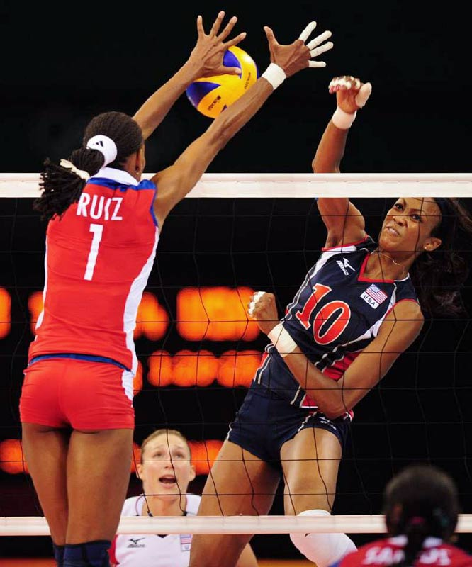 Kimberly Glass attempts to get the ball past Yumilka Ruiz of Cuba.