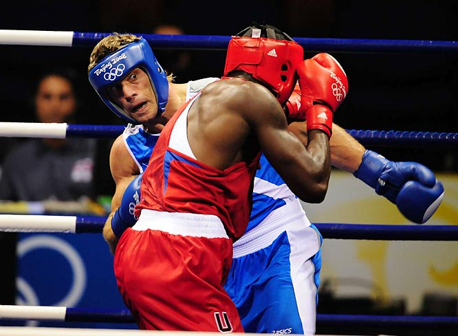 Deontay Wilder of the U.S.  (red shorts) fights Clemente Russo of Italy (blue shorts) in the men's heavyweight semifinals.
