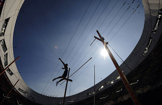 American Bryan Clay inched closer to the Olympic decathlon gold on Friday by leaping five meters in the pole vault to go into the evening's last two events 316 points clear of the field.