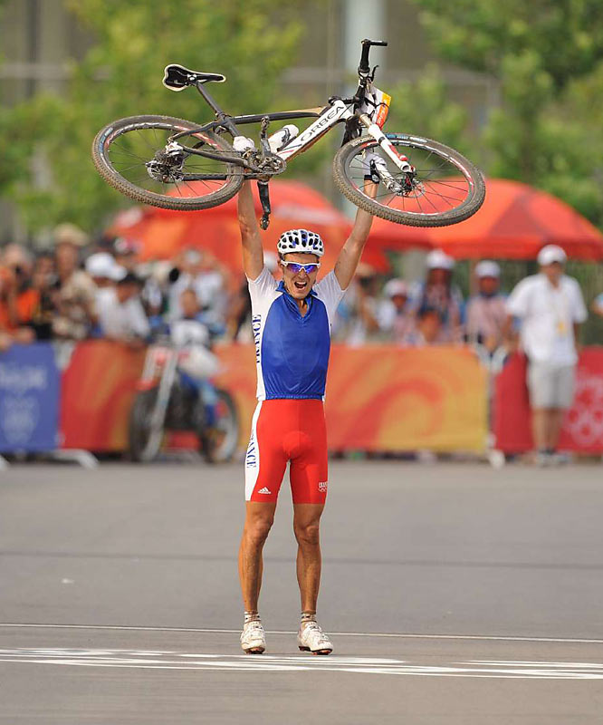 Julien Absalon of France celebrates winning the gold in the cross country mountain bike finals.