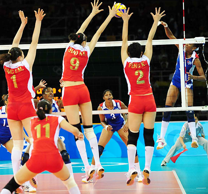 Wang Yimei (1), Zhao Ruirui (9) and Feng Kun (2) of China play Cuba for the bronze medal in women's volleyball.