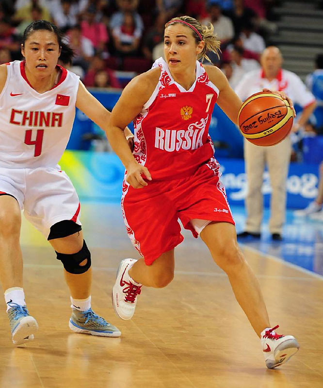 Becky Hammon scored 22 points to help Russia beat host China 94-81 Saturday night for the Olympic bronze medal.