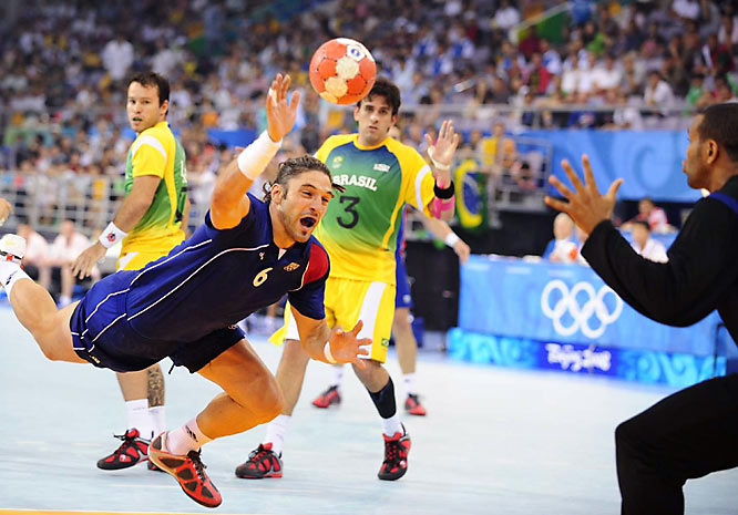 French handball player Bertrand Gille attempts to score on Brazil in the preliminaries.