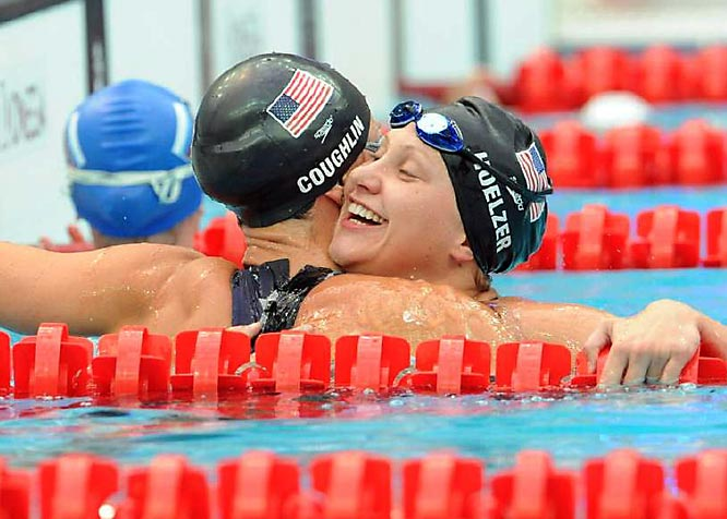 Margaret Hoelzer hugs Natalie Coughlin after they finished third and first, respectively, in the 100m backstroke.