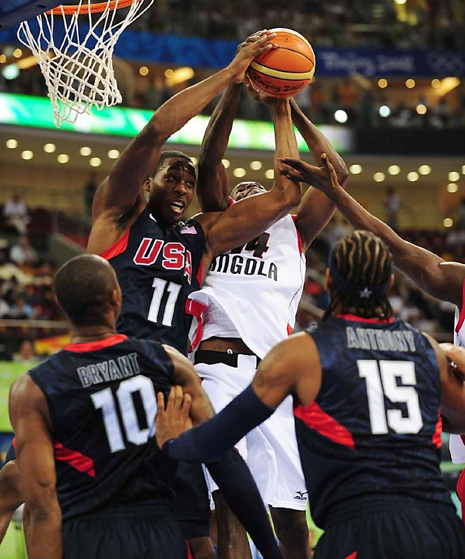 Dwight Howard (11) battles with Leonel Paulo of Angola for a rebound during the Redeem Team's 97-76 victory.