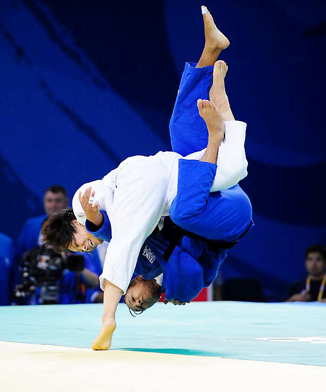 Ayumi Tanimoto of Japan (white) gets the better of France's Lucie Decosse in judo.  Tanimoto won the gold and Decosse the silver.