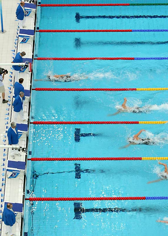 Michael Phelps won his third gold medal with his victory in the 200 meter freestyle. He swam in world record time of 1:42.96.