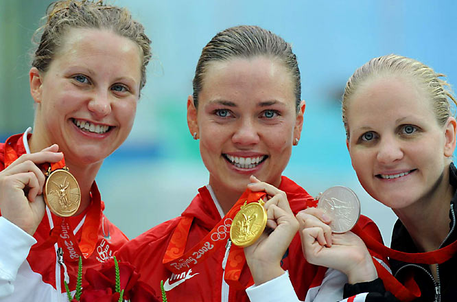Coughlin shows off her gold along with fellow medalists Margaret Hoelzer (bronze) and Kirsty Coventry (silver).