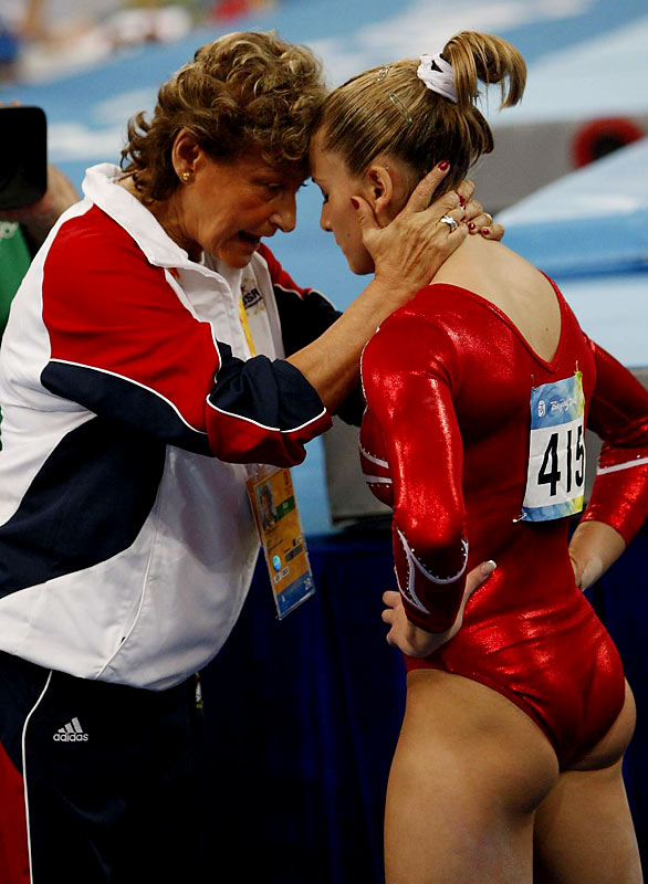 Alicia Sacramone gets consoled by Martha Karolyi during the gymnastics final.