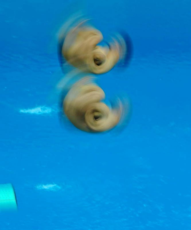 A long shutter-exposure image of Chris Cowill and Jevon Tarantino, who placed fourth in the synchronized 3m springboard.