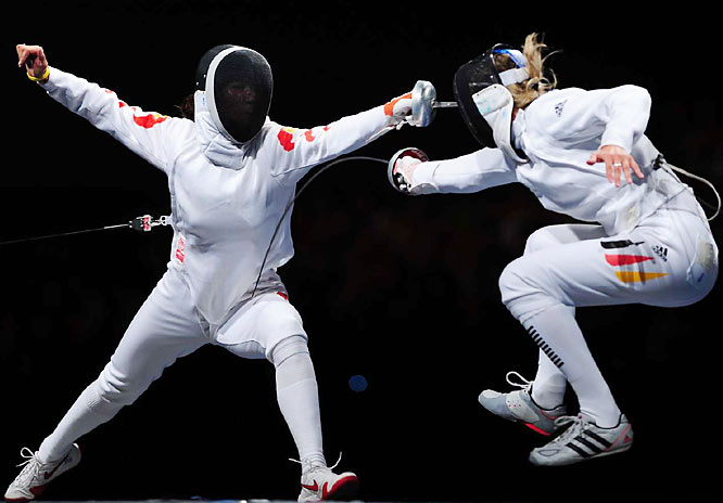 Britta Heidemann of Germany scores against Li Naof China during an individual epee semifinal.