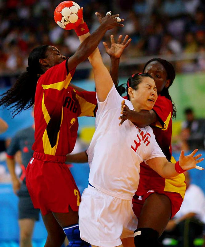 Liu Yun of China battles Angola's Maria Teresa Neto Joaquim Eduardo (left) and Elizabeth Amelia Basilio Viegas in the team handball preliminaries.