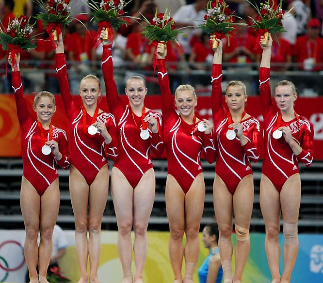 American gymnasts (L-R) Shawn Johnson, Nastia Liukin, Chelsie Memmel, Samantha Peszek, Alicia Sacramone and Bridget Sloan wave flowers after receiving their silver medals in the Team Final on Wednesday. The Chinese team won the gold medal and the Romanians won the bronze.
