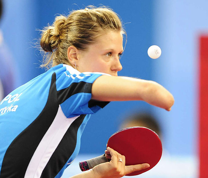 Natalia Partyka of Poland competes in the women's team preliminaries of the table tennis event.