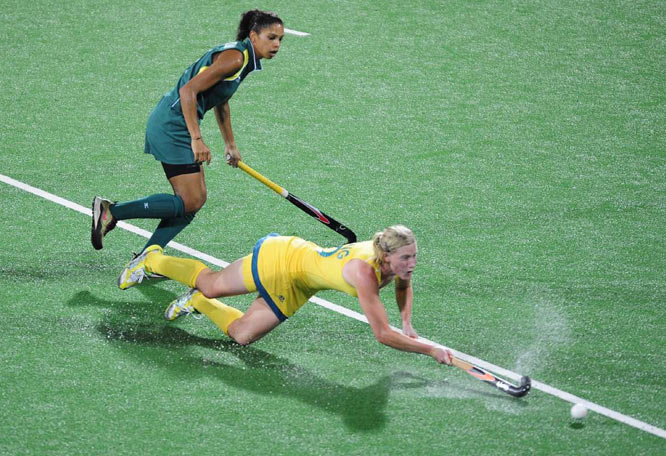 Sarah Young of Australia loses her footing in a 3-0 win over South Africa.