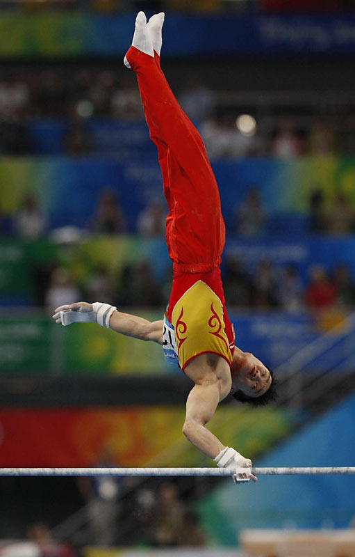 Yang Wei of China won the gold in the individual all-around final after failing in Sydney and Athens.