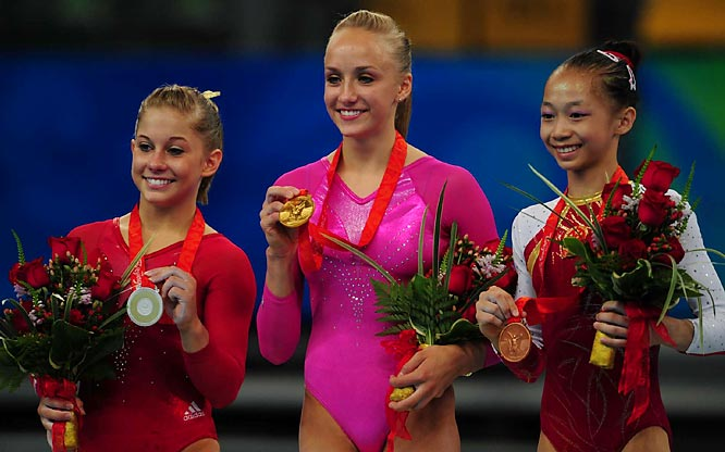 Shawn Johnson of the U.S. (silver), Nastia Liukin (gold) and Yang Yilin of China (bronze) show off their hardware after the individual all-around final.