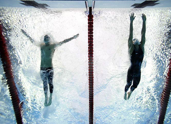 Michael Phelps (far left) edged Milorad Cavic, of Serbia, by 0.01 seconds to win the 100-meter butterfly. With the victory, the 23-year-old American pulled even with Mark Spitz's seven gold medals from the 1972 Munich Games.