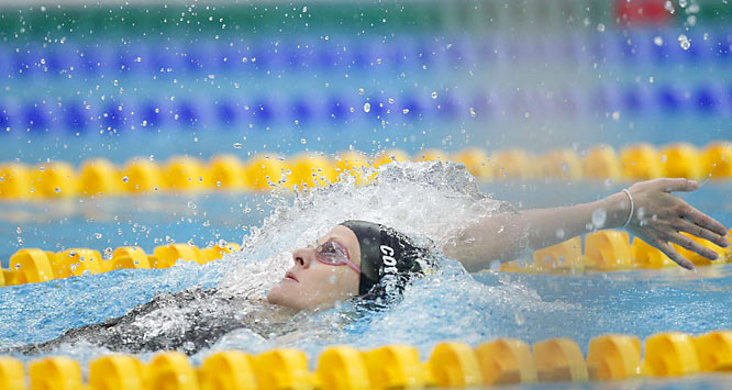 After taking three silver medals, Zimbabwe's Kirsty Coventry (left) won her first gold in Beijing, defending her title in the women's 200-meter backstroke. Her time of 2.05.24 set a world record in the race.