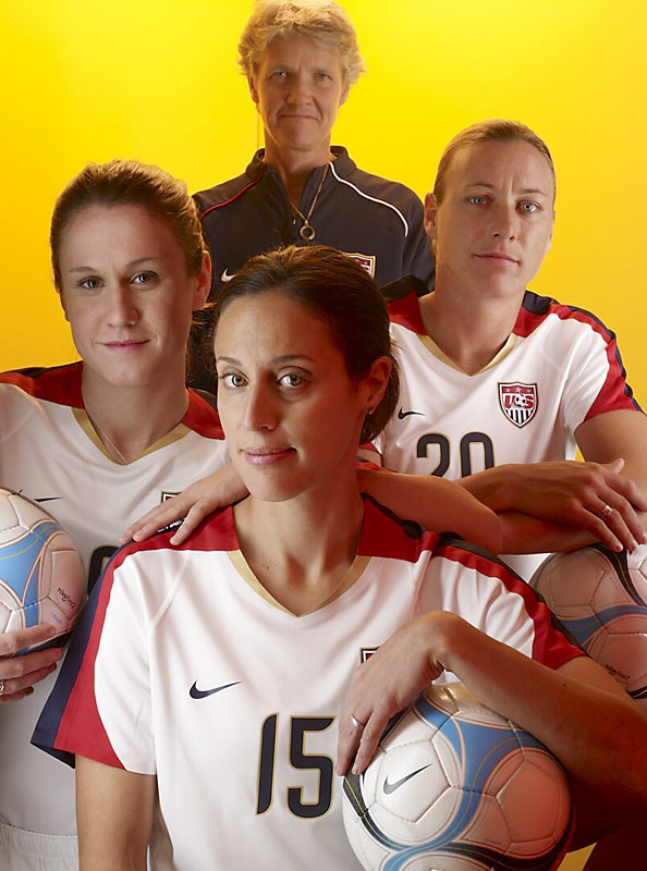 Left to right: Heather O'Reilly, Kate Markgraf (15), Abby Wambach and U.S. soccer coach Pia Sundhage.