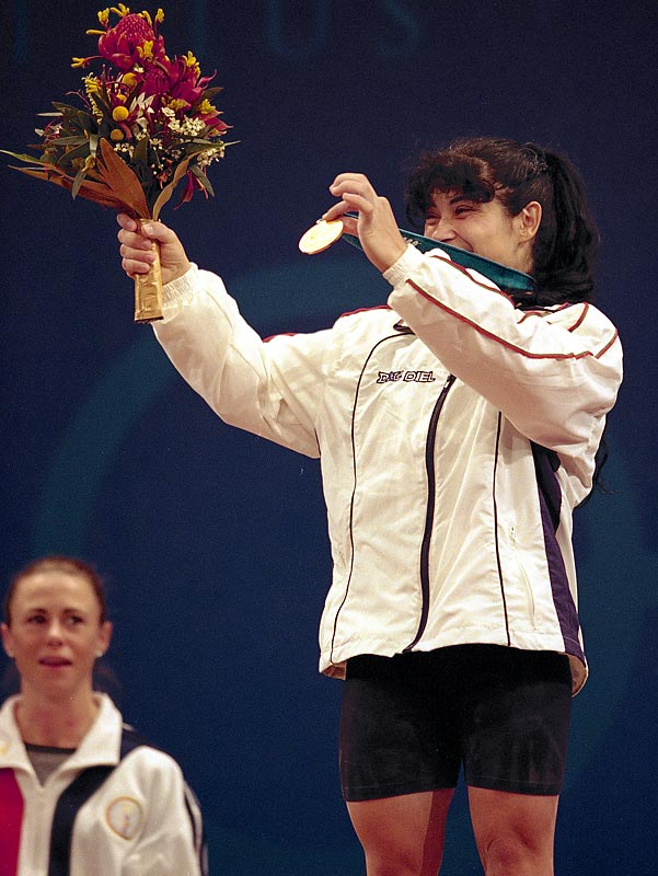 "Bulgaria's Izabela Dragneva -- the first women's weightlifting champion in Olympic history -- and bronze medalist Sevdalin Minchev were stripped of their medals and booted from the 2000 Olympics after testing positive for a banned diuretic. Bulgaria's entire weightlifting team was also given the bum's rush from Sydney and suspended from international competition for a year after it refused to fork over a $50,000 fine. ""They have brought the sport of weightlifting into worthless repute,"" lamented IWF vice president Sam Coffa."