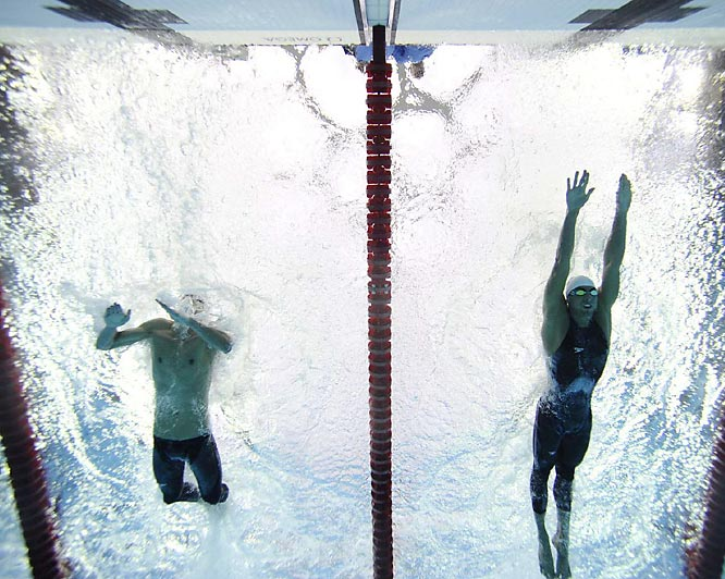 Phelps made a critical decision in the final meters to attempt another half-stroke while Serbia's Milorad Cavic (right) tried to glide to the finish.