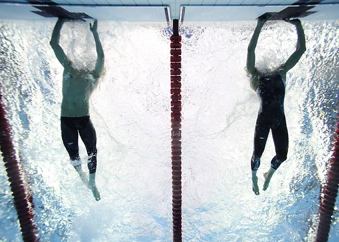 Phelps won the same event in similar fashion at the 2004 Olympics, out-touching American Ian Crocker after trailing and winning the gold by .04 seconds.