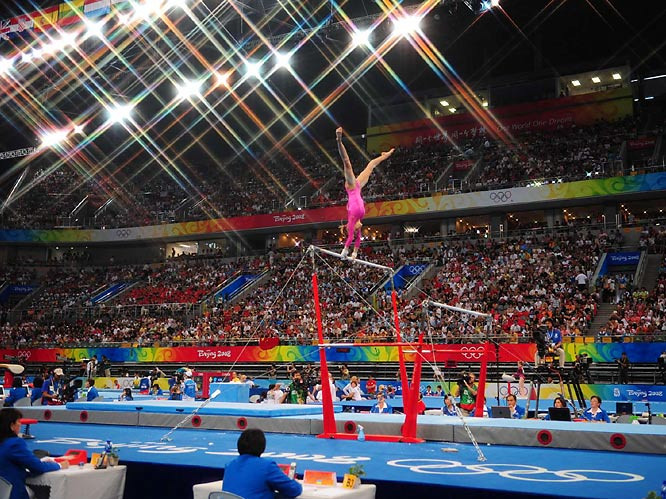 Nastia Liukin of the U.S. edged teammate Shawn Johnson for the gold medal in women's all-around gymnastics on Friday in Beijing. Yang Yilin of China won the bronze. In a showdown of the world's two best gymnasts, Liukin finished with 63.325 points -- six-tenths ahead of Johnson, who is the reigning world champion. Johnson had bested Liukin at the U.S. championships and Olympic trials.