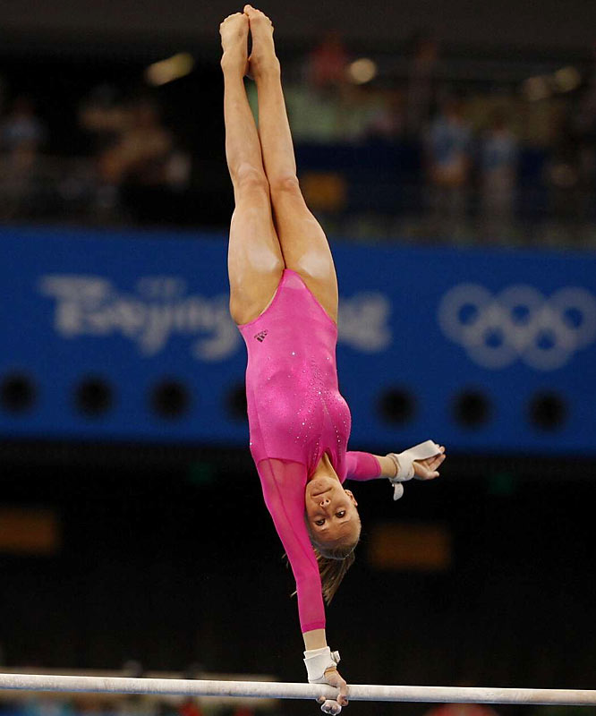 After finding herself in 10th place, Liukin rallied in two of her best events (scoring 16.650 on bars and 16.125 on beam) to take the lead going into floor exercise.