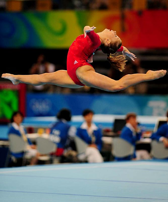Johnson, the final competitor, completed her performance as Liukin anxiously paced while clapping for her teammate.