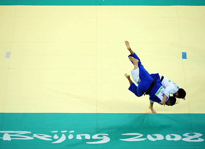 Ayumi Tanimoto of Japan (white) and Lucie Decosse of France in judo.
