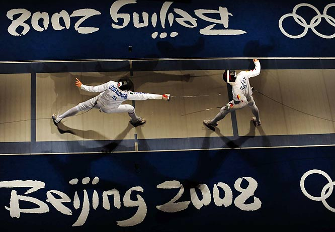Diego Confalonieri of Italy vs. Dong Guotao of China during team epee competition.