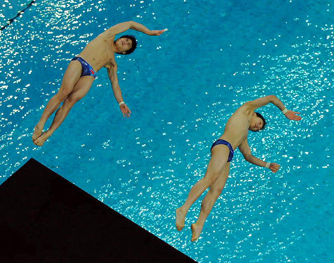 SI photographers and their peers had some unique vantage points at the Olympics. Here's a collection of their overhead shots, beginning with this one of Yue Lin and Liang Huo, gold medalists in synchronized diving.