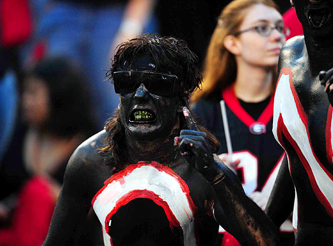 This Georgia fan did such a thorough paint job, he even got some on his teeth.